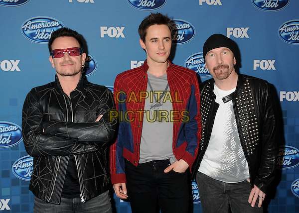 "BONO (Paul Hewson), REEVE CARNEY & THE EDGE (David Howell Evans).""American Idol 2011"" Finale - Press Room held at Nokia Theatre LA Live, Los Angeles, California, USA..May 25th, 2011.half length black leather jacket arms crossed sunglasses shades studs studded U2 grey gray red spiderman print goatee facial hair beanie hat.CAP/ADM/BP.©Byron Purvis/AdMedia/Capital Pictures."