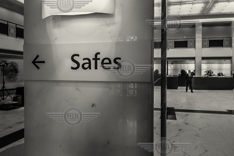 A sign inside an Union des Banques Suisse (UBS) building points the way to the safes.