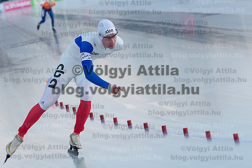 France's Alexis Contin (front) and Netherlands' Ted-Jan Bloemen (back) compete in the Men's 10000m race of the Speed Skating All-round European Championships in Budapest, Hungary on January 8, 2012. ATTILA VOLGYI
