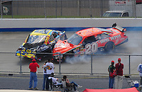 Jun 1, 2008; Dover, DE, USA; NASCAR Sprint Cup Series driver Elliott Sadler (19) is hit by Tony Stewart (20) during a multiple car crash in the Best Buy 400 at the Dover International Speedway. Mandatory Credit: Mark J. Rebilas-US PRESSWIRE