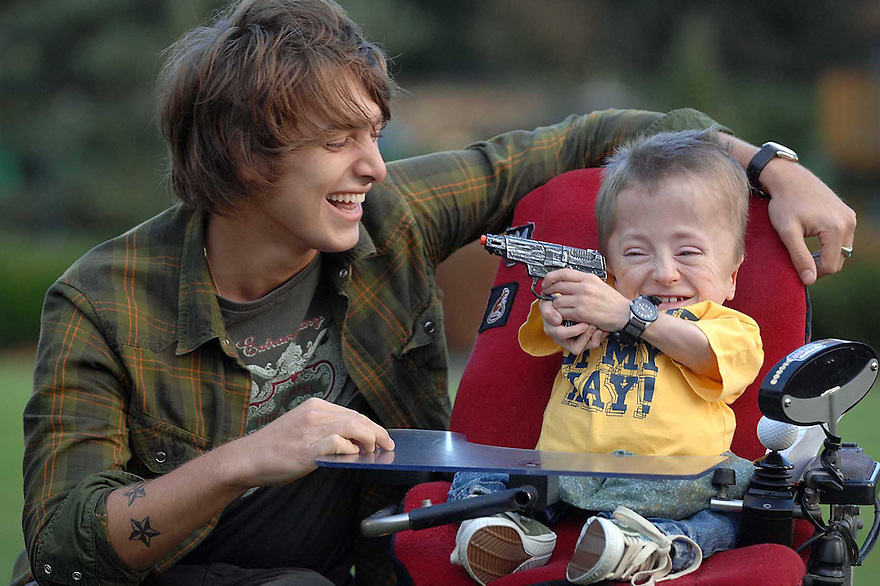 Singer song writer Paolo Nutini and his new best friend Richard Toner during his visit to Rachel House in Kinross......