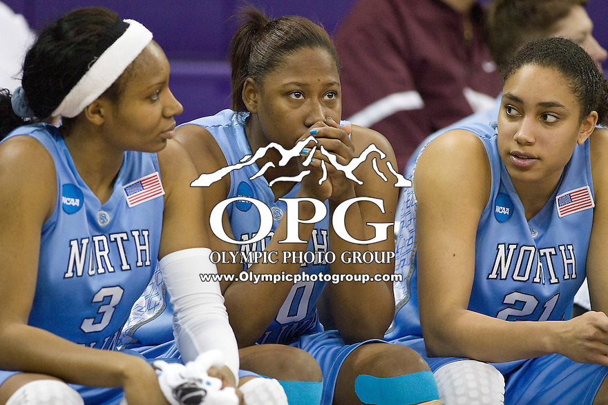 20 March 2010:  University of North Carolina players (left) Trinity Bursey, (center) #00 Nyree Williams and (right) Krista Gross sit on the bench dejected as time runs off the clock in the final seconds of the game against Goonzaga. Gonzaga won 82-76 over the University of North Carolina at Bank of America Arena in Seattle, WA.