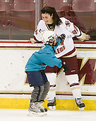 Mary Restuccia (BC - 22) plays with a young fan. - The Boston College Eagles women's team hosted a fan skate following their victory over Harvard on Sunday, December 5, 2010, at Conte Forum in Chestnut Hill, Massachusetts.