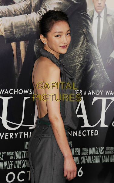 "Xun Zhou.Los Angeles premiere of Warner Brothers Pictures' ""Cloud Atlas"" at Grauman's Chinese Theater. Hollywood, CA USA..October 24th, 2012.half length grey gray jumpsuit cowl neck sleeveless twisted halterneck backless side .CAP/ROT/TM.© TM/Roth/Capital Pictures"