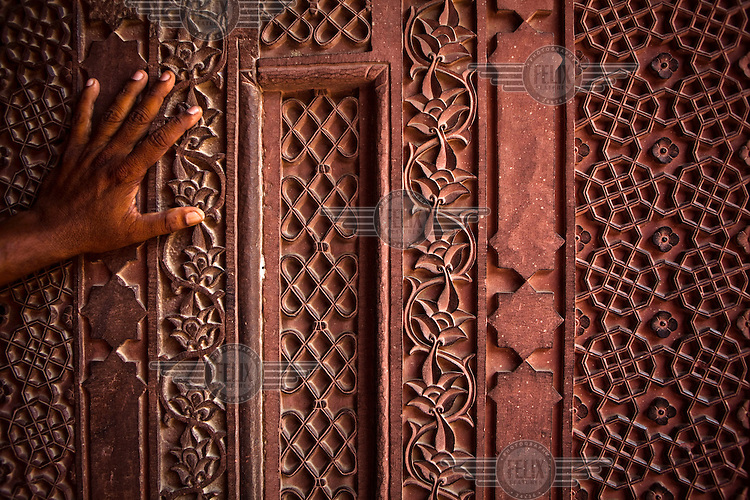 Intricate designs carved on one of the pillars of Agra Fort.