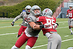 Peyton Pelluer (#47) makes the tackle for the Gray squad during the annual Washington State Cougar spring game, the Crimson and Gray game, at Joe Albi Stadium in Spokane, Washington, on April 25, 2015.