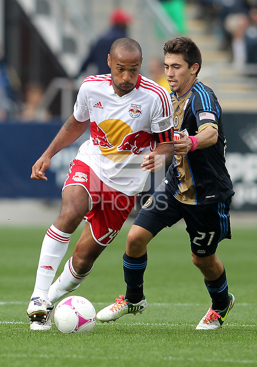 CHESTER, PA - OCTOBER 27, 2012:  Michael Farfan (21) of the Philadelphia Union makes a grab for  Thierry Henry (14) of the New York Red Bulls during an MLS match at PPL Park in Chester, PA. on October 27. Red Bulls won 3-0.