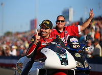 Mar 16, 2018; Gainesville, FL, USA; NHRA pro stock motorcycle rider Hector Arana Jr celebrates after becoming the first pro stock motorcycle rider to break the 200 mph speed barrier during qualifying for the Gatornationals at Gainesville Raceway. Mandatory Credit: Mark J. Rebilas-USA TODAY Sports