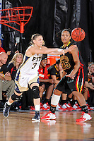 25 November 2011:  FIU guard Zsofia Labady (3) passes the ball as Maryland guard-forward Alyssa Thomas (25) looks on in the first half as the University of Maryland Terrapins defeated the FIU Golden Panthers, 84-52, at the U.S. Century Bank Arena in Miami, Florida.