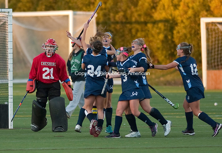 WETHERSFIELD, CT--- -112115JS13--Cheshire's Alyssa Stevens (21) makes her way off the field as Wilton players celebrates their 1-0 overtime win to take the Class L championship Saturday at Wethersfield High School.<br /> Jim Shannon Republican-American