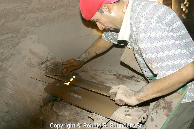 MAN IN UNDERGROUND KILN WORKS to HARDEN TOOLS