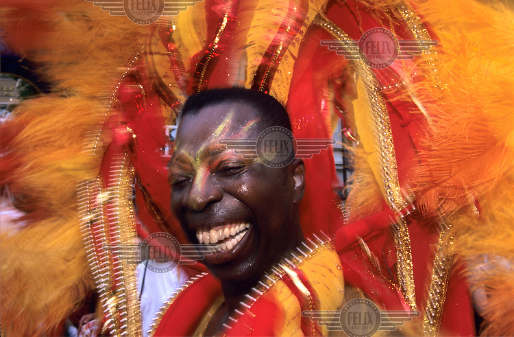 Man laughing wearing a coloured costume at the Carnival of Cultures...