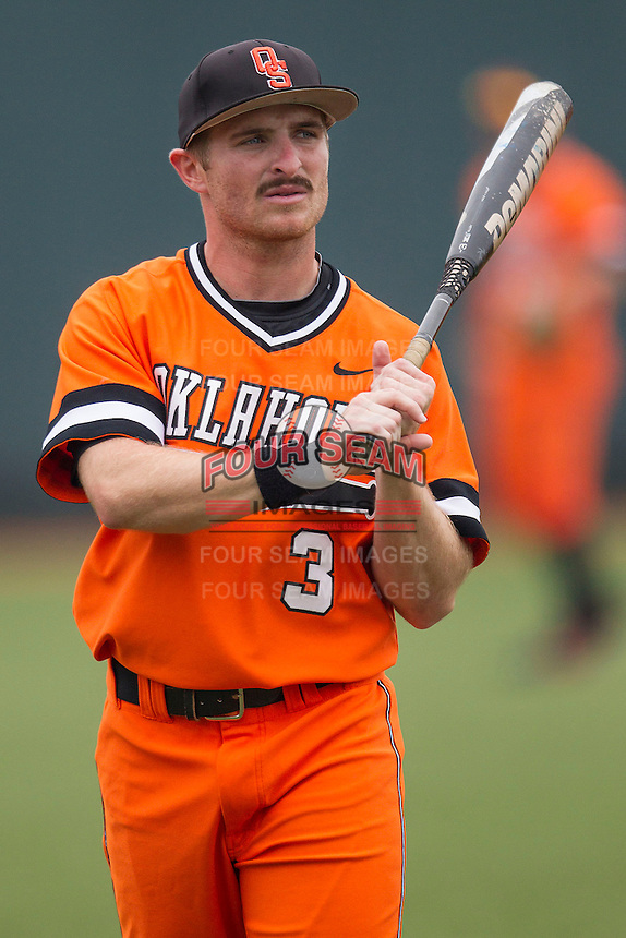 Oklahoma State Cowboys outfielder Saulyer Saxon #3 before the NCAA baseball game against the Texas Longhorns on April 26, 2014 at UFCU Disch–Falk Field in Austin, Texas. The Cowboys defeated the Longhorns 2-1. (Andrew Woolley/Four Seam Images)