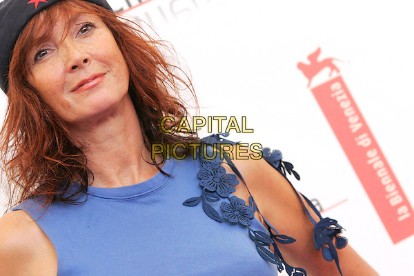 "SABINE AZEMA.Photocall for film ""Le Parfum de la Dame Noire"".62nd Venice Film Festival.September 7th, 2005.headshot portrait hat cut out flowers floral blue purple.www.capitalpictures.com.sales@capitalpictures.com.© Capital Pictures."