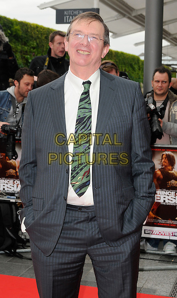 """MIKE NEWELL, Director .At the World Film Premiere of """"Prince of Persia: The Sands Of Time"""", Vue cinema at Westfield shopping centre, London, England, 9th May 2010..arrivals half length grey gray suit green tie glasses hands in pockets pinstripe .CAP/CAN.©Can Nguyen/Capital Pictures."""