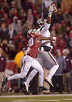 NWA Democrat-Gazette/BEN GOFF @NWABENGOFF<br /> Fred Ross, Mississippi State wide receiver, catches a pass under pressure from Kevin Richardson, Arkansas strong safety, in true second quarter on Saturday Nov. 21, 2015 during the game in Razorback Stadium in Fayetteville. Ross ran the ball for a touchdown on the play.