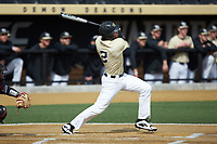Johnny Aiello (2) of the Wake Forest Demon Deacons follows through on his first inning grand slam against the Louisville Cardinals at David F. Couch Ballpark on March 18, 2018 in  Winston-Salem, North Carolina.  The Demon Deacons defeated the Cardinals 6-3.  (Brian Westerholt/Four Seam Images)