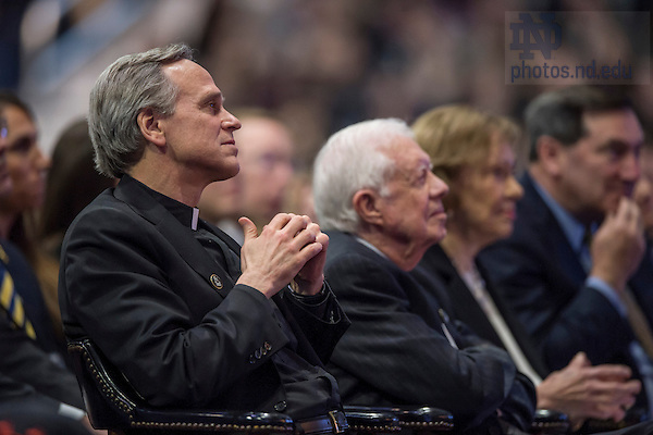 Mar. 4, 2015; University President Rev. John Jenkins, C.S.C., listens to a speaker during the tribute ceremony in the Purcell Pavilion to honor the life of the late President Emeritus Rev. Theodore M. Hesburgh, C.S.C. (Photo by Barbara Johnston/University of Notre Dame)