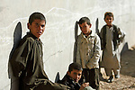 Mcc0018106 . SundayTelegraph..For the Sunday Telegraph..Afghan boys at a wheat distribution point adjacent to British base Fob Shawqat in the Nad e'Ali district of Helmand province, southern Afghanistan...Afghanistan 10 November 09