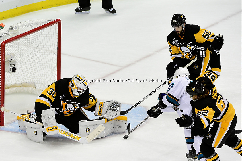 Thursday, June 9, 2016: Pittsburgh Penguins goalie Matt Murray (30) stops a shot by San Jose Sharks right wing Joonas Donskoi (27) during game 5 of the NHL Stanley Cup Finals  between the San Jose Sharks and the Pittsburgh Penguins held at the CONSOL Energy Center in Pittsburgh Pennsylvania. The Sharks defeat the Penguins 4-2 in regulation time. The Penguins lead the best of seven series 3-2. Eric Canha/CSM