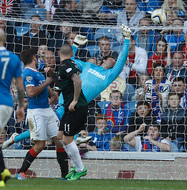 Martin Scott heads in past Rangers keeper Steve Simonsen to score for Raith Rovers