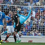 Martin Scott heads in past Rangers keeper Steve Simonsen to score for Raith Rovers