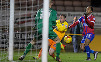 Michael Harriman of Wycombe Wanderers beats Ashley Hemmings of Dagenham & redbridge & Goalkeeper Mark Cousins of Dagenham & redbridge to make an assist for Wycombe's first goal during the Sky Bet League 2 match between Dagenham and Redbridge and Wycombe Wanderers at the London Borough of Barking and Dagenham Stadium, London, England on 9 February 2016. Photo by Andy Rowland.