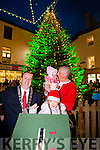 Kerry Captain Kierain Donaghy holding his daughter Lola Rose, Mayor Tom McEllistrim and Emma Lynch Caharlaheen NS winner of the christmas Colouring competitionturn on the Christmas lights in Tralee on Saturday last.