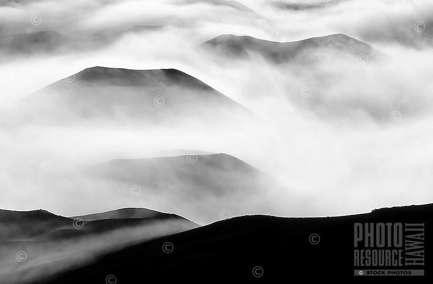 Clouds settle around cinder cones including Pu'u O Maui, the tallest cinder cone in Haleakala National Park, Maui.