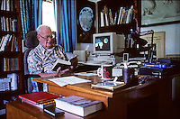 "Arthur C. Clarke with his dog at his home in Sri Lanka in 1996. He is perhaps most famous for being co-writer of the screenplay for the movie 2001: A Space Odyssey, considered by the American Film Institute to be one of the most influential films of all time. His other science fiction writings earned him a number of Hugo and Nebula awards, along with a large readership, making him into one of the towering figures of the field. For many years he, along with Robert Heinlein and Isaac Asimov, were known as the ""Big Three"" of science fiction. Clarke died in 2008 at age 90."