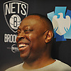 Tony Brown, interim head coach of the Brooklyn Nets, laughs as he speaks to the media after a team shootaround at Barclays Center on Monday, Jan. 11, 2016.