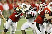January 5th, 2008:  Rutgers defensive tackle Eric Foster (56) breaks through the block of Ball State lineman Michael Switzer (74) during the fourth quarter of the International Bowl at the Rogers Centre in Toronto, Ontario Canada...Rutgers defeated Ball State 52-30.  ..Photo By:  Mike Janes Photography