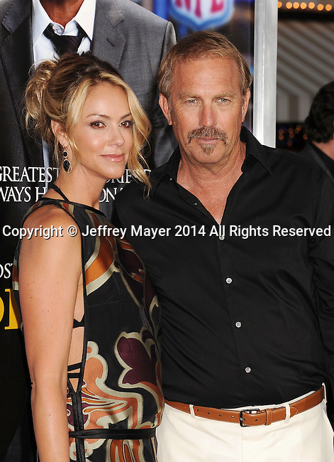 WESTWOOD, CA- APRIL 07: Actor Kevin Costner (R) and Christine Baumgartner attend the Los Angeles premiere of 'Draft Day' at the Regency Village Theatre on April 7, 2014 in Westwood, California.