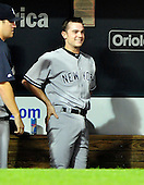 New York Yankees pitcher David Robertson (30) smiles in the dugout after pitching out of a bases loaded, no out situation in the eighth inning without allowing a run against the Baltimore Orioles at Oriole Park at Camden Yards in Baltimore, Maryland in the second game of a doubleheader on Sunday, August 28, 2011.  The Yankees won the game 8 - 3, earning a split in the two games..Credit: Ron Sachs / CNP.(RESTRICTION: NO New York or New Jersey Newspapers or newspapers within a 75 mile radius of New York City)