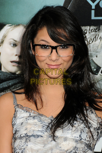 """FIVEL STEWART.Premiere of """"Unknown"""" held at The Regency Village Theatre in Westwood, California, USA..February 16th, 2011.headshot portrait grey gray floral print glasses .CAP/ADM/BP.©Byron Purvis/AdMedia/Capital Pictures."""