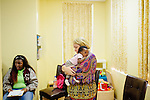 Laura Grumbling, who is in charge of client operations, closes her eyes during a prayer as she holds Selea Moore, 2 months, during a class at the Pregnancy Aid Clinic in Hapeville, Georgia, while the baby's mother Sequoia Tonge (not pictured), 23, sits nearby. The clinic offers women free support, including ultrasounds, pregnancy tests, classes, and supplies. Seen November 7, 2013. Sequoia first found out she was pregnant at the clinic.