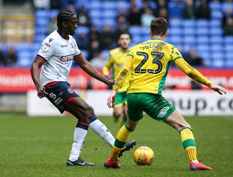 Bolton Wanderers' Clayton Donaldson competing with Norwich City's Kenny McLean  <br /> <br /> Photographer Andrew Kearns/CameraSport<br /> <br /> The EFL Sky Bet Championship - Bolton Wanderers v Norwich City - Saturday 16th February 2019 - University of Bolton Stadium - Bolton<br /> <br /> World Copyright © 2019 CameraSport. All rights reserved. 43 Linden Ave. Countesthorpe. Leicester. England. LE8 5PG - Tel: +44 (0) 116 277 4147 - admin@camerasport.com - www.camerasport.com