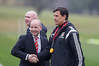 FAW chief executive Jonathan Ford greets team manager Chris Coleman with talks on the manager's contract extension unresolved, during Wales national team training ahead of the International Friendly match and Euro 2016 warm up match against Northern Ireland at Vale Resort, Hensol, Wales on 22 March 2016. Photo by Mark  Hawkins / PRiME Media Images.