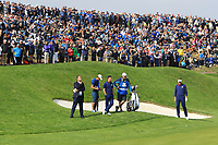 Rory McIlroy and Ian Poulter (Team Europe) on the 1st green during the Friday Foursomes at the Ryder Cup, Le Golf National, Ile-de-France, France. 28/09/2018.<br /> Picture Thos Caffrey / Golffile.ie<br /> <br /> All photo usage must carry mandatory copyright credit (&copy; Golffile | Thos Caffrey)