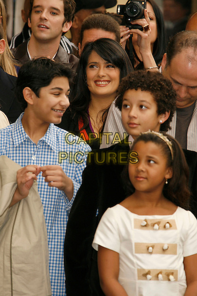 MARK INDELICATO, SALMA HAYEK, MICHAEL URIE, DEVIN & SASHA.Vanessa L. Williams Celebrates Her Birthday With a Star On The Hollywood Walk of Fame, Holllywood, California, USA..March 19th, 2007 .half length blue shirt black crowd .CAP/ADM/RE.©Russ Elliot/AdMedia/Capital Pictures