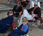 Corine, Mitch, 8-year-old Mason and 6-year-old Walker watch the Reno Rodeo Parade held in Midtown on Virginia Street on Saturday, June 18, 2016.