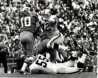 San Francisco 49ers quarterback George Mira is rushed by Oakland Raiders Bill Laskey, amd Dan Connrs..(1968 photo/Ron Riesterer)
