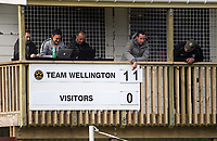 Team Wellington board member Ryan Holland places a one over the 10 on the scoreboard after the 11th goal during the 2018 OFC Champions League Quarterfinal between Team Wellington and Lae City Dwellers FC at David Farrington Park in Wellington, New Zealand on Saturday, 7 April 2018. Photo: Dave Lintott / lintottphoto.co.nz