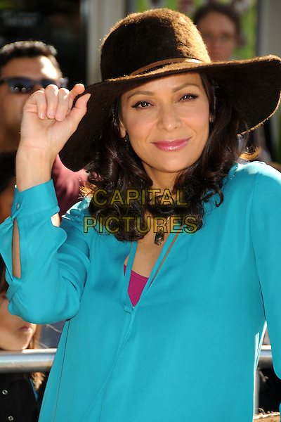 Constance Marie.The L.A. Premiere of 'Puss in Boots' held at The Regency Village Theatre in Westwood, California, USA..October 23rd, 2011.half length  blue turquoise shirt hat  .CAP/ADM/BP.©Byron Purvis/AdMedia/Capital Pictures.