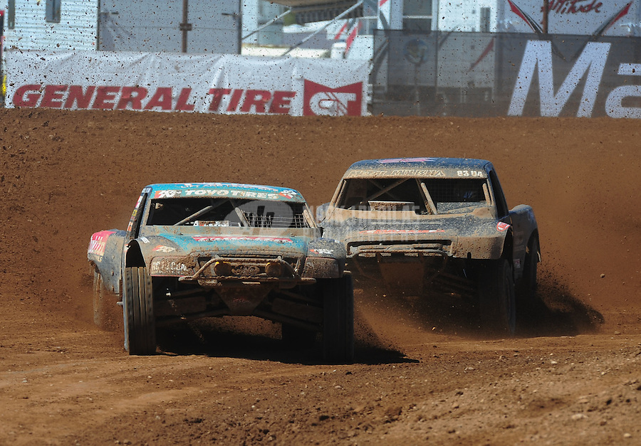 Apr 16, 2011; Surprise, AZ USA; LOORRS driver Curt Leduc (43) leads Steve Barlow (83) during round 3 at Speedworld Off Road Park. Mandatory Credit: Mark J. Rebilas-.
