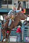 George Gillespie competes in the bareback bronc riding event at the Reno Rodeo, in Reno, Nev. on Friday night, June 22, 2012..Photo by Cathleen Allison