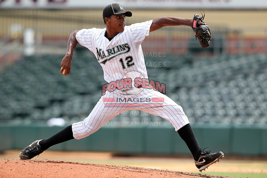 Pitcher Helpi Reyes #12 of the Florida Marlins instructional League team during a game against the Italian National Team at the Roger Dean Stadium in Jupiter, Florida;  September 27, 2011.  Italy is training in Florida for the Baseball World Cup.  (Mike Janes/Four Seam Images)