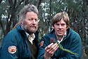 Wyn Jones and Dave Noble holding branch of Wollemi Pine in National park where discovered.
