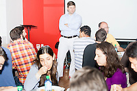John Fawcett, the CEO and co-founder of Quantopian, (in light blue shirt) speaks to employees about company policies during a team lunch in the offices of Quantopian in the Downtown Crossing area of Boston, Mass., on Wed., June 1, 2016. Quantopian is a Boston-based start-up that provides a platform for building, testing, and executing stock trading algorithms.