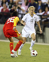 Kristine Lilly #13 of the USA WNT moves towards Nan Zhang #26 of the PRC WNT during an international friendly match at KSU Soccer Stadium, on October 2 2010 in Kennesaw, Georgia. USA won 2-1.